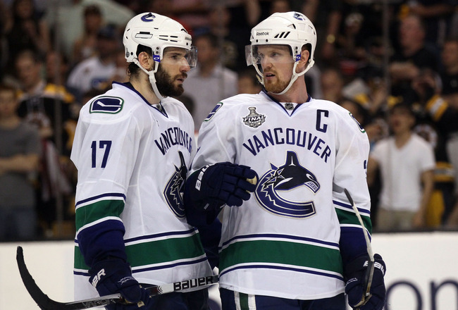 BOSTON, MA - JUNE 08:  Ryan Kesler #17 of the Vancouver Canucks talks with teammate Henrik Sedin #33 during Game Four against the Boston Bruins in the 2011 NHL Stanley Cup Final at TD Garden on June 8, 2011 in Boston, Massachusetts.  (Photo by Elsa/Getty