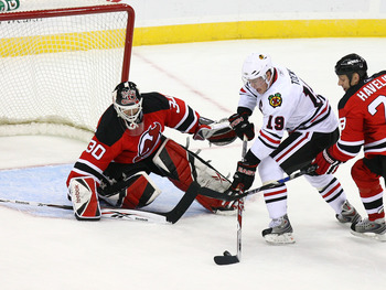 NEWARK, NJ - MARCH 17:  Goaltender Martin Brodeur #30 of the New Jersey Devils defends the net as Jonathan Towes #19 of the Chicago Blackhawks looks to score during their game on March 17, 2009 at The Prudential Center in Newark, New Jersey.  (Photo by Al