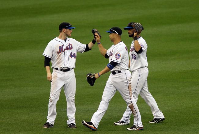 NEW YORK, NY - JUNE 23: Jason Bay #44, Carlos Beltran #15 and Angel Pagan #16 of the New York Mets celebrate after defeating the Oakland Athletics at Citi Field on June 23, 2011 in the Flushing neighborhood of the Queens borough of New York City.  (Photo