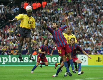 PARIS - MAY 17:  Sol Campbell (R) of Arsenal rises above Presas Oleguer of Barcelona to score the first goal  during the UEFA Champions League Final between Arsenal and Barcelona at the Stade de France on May 17, 2006 in Paris, France.  (Photo by Laurence