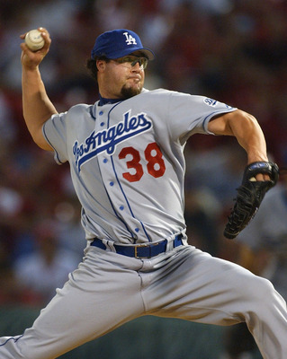 ST LOUIS - OCTOBER 7:  Eric Gagne #38 of the Los Angeles Dodgers pitches against the St. Louis Cardinals in Game two of National League Division Series on October 7, 2004 at Busch Stadium in St. Louis, Missouri.  The Cardinals defeated the Dodgers 8-3 to