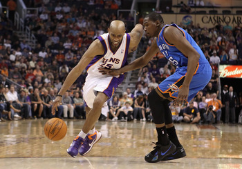 PHOENIX, AZ - MARCH 30:  Vince Carter #25 of the Phoenix Suns drives the ball past Kevin Durant #35 of the Oklahoma City Thunder during the NBA game at US Airways Center on March 30, 2011 in Phoenix, Arizona.  The Thunder defeated the Suns 116-98.  NOTE T