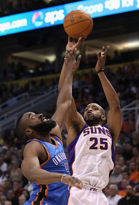 PHOENIX, AZ - MARCH 30:  Vince Carter #25 of the Phoenix Suns puts up a shot over James Harden #13 of the Oklahoma City Thunder during the NBA game at US Airways Center on March 30, 2011 in Phoenix, Arizona.  The Thunder defeated the Suns 116-98. NOTE TO
