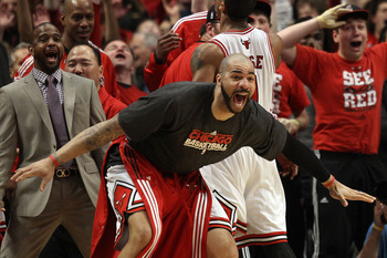 CHICAGO, IL - MAY 15:  Carlos Boozer #5 of the Chicago Bulls celebrates on the bench against the Miami Heat in Game One of the Eastern Conference Finals during the 2011 NBA Playoffs on May 15, 2011 at the United Center in Chicago, Illinois. NOTE TO USER: