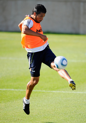 LOS ANGELES, CA - AUGUST 06:   Ezequiel Marcelo Garay #19 of Real Madrid kicks the ball during training session on the campus of UCLA on August 6, 2010 inthe Westwood section  Los Angeles, California. Real Madrid will play a pre-season friendly soccer mat