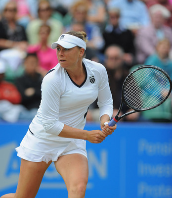 EASTBOURNE, ENGLAND - JUNE 15:  Vera Zvonareva of Russia in action against Serena Williams of USA  during day five of the AEGON International at Devonshire Park on June 15, 2011 in Eastbourne, England.  (Photo by Mike Hewitt/Getty Images)