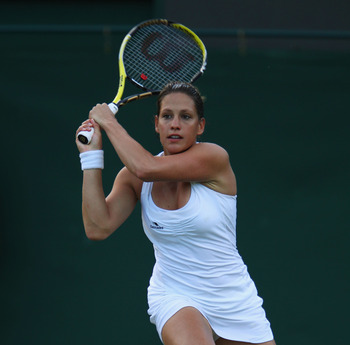 LONDON, ENGLAND - JUNE 22:  Stephanie Dubois of Canada in action during her second round match against Andrea Petkovic of Germany on Day Three of the Wimbledon Lawn Tennis Championships at the All England Lawn Tennis and Croquet Club on June 22, 2011 in L