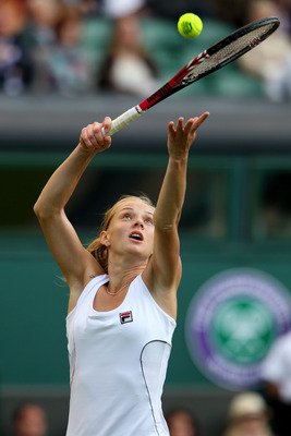 LONDON, ENGLAND - JUNE 21:  Anna Chakvetadze of Russia serves during her first round match against Maria Sharapova of Russia on Day Two of the Wimbledon Lawn Tennis Championships at the All England Lawn Tennis and Croquet Club on June 21, 2011 in London,