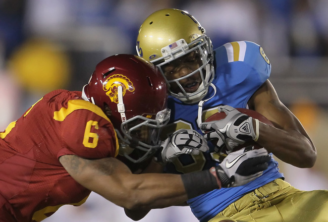 PASADENA, CA - DECEMBER 04:  Malcolm Smith #6 of the USC Trojans tackles Nelson Rosario #83 of the UCLA Bruins during the first half at the Rose Bowl on December 4, 2010 in Pasadena, California. USC defeated UCLA 28-14.  (Photo by Jeff Gross/Getty Images)