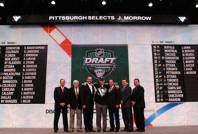 ST PAUL, MN - JUNE 24:  23rd overall pick Joe Morrow ny of the Pittsburgh Penguins stands onstage with members of the Pittsburgh Penguins organization during day one of the 2011 NHL Entry Draft at Xcel Energy Center on June 24, 2011 in St Paul, Minnesota.