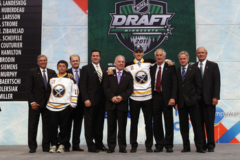 ST PAUL, MN - JUNE 24:  Sixteenth overall pick Joel Armia by the Buffalo Sabres stands onstage for a photo with members of the Buffalo Sabres organization during day one of the 2011 NHL Entry Draft at Xcel Energy Center on June 24, 2011 in St Paul, Minnes