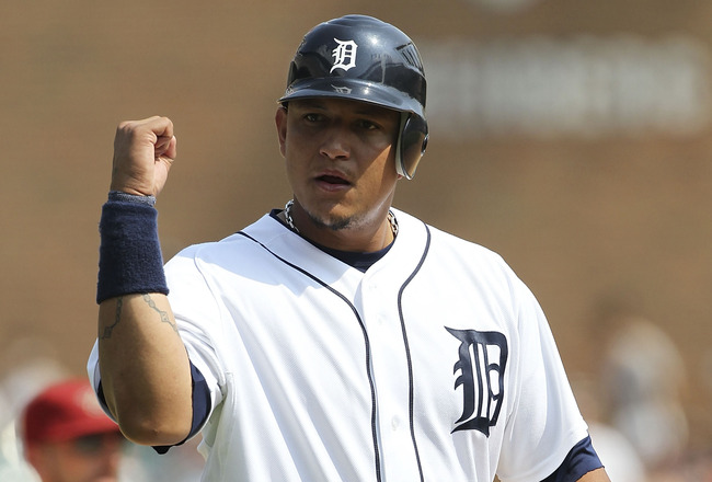 DETROIT - JUNE 26: Miguel Caberea #24 of the Detroit Tigers celebrates after Victor Martinez #41 singles to deep center field in the eight inning during the game against the Arizona Diamondbacks at Comerica Park on June 26, 2011 in Detroit, Michigan. The