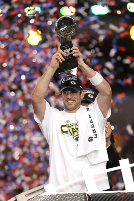 ARLINGTON, TX - FEBRUARY 06:  MVP Aaron Rodgers #12 of the Green Bay Packers holds up The Vince Lombardi Trophy after the Green Bay Packers defeated the Pittsburgh Steelers 31 to 25 in Super Bowl XLV at Cowboys Stadium on February 6, 2011 in Arlington, Te