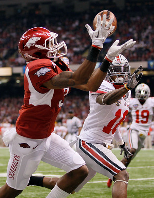 NEW ORLEANS, LA - JANUARY 04:  Joe Adams #3 of the Arkansas Razorbacks catches a 17-yard touchdown pass in the endzone against Travis Howard #18 of the Ohio State Buckeyes in the first quarter during the Allstate Sugar Bowl at the Louisiana Superdome on J