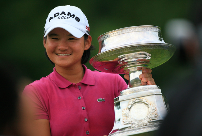 PITTSFORD, NY - JUNE 26: Yani Tseng of Taiwan holds the championship trophy on the 18th green after winning the Wegmans LPGA Championship at Locust Hill Country Club on June 26, 2011 in Pittsford, New York. (Photo by Hunter Martin/Getty Images)