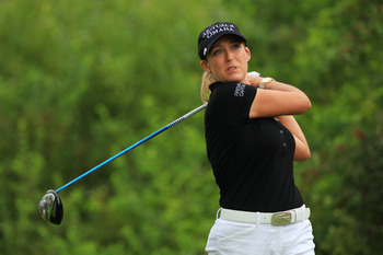 PITTSFORD, NY - JUNE 26: Cristie Kerr hits her tee shot on the second hole during the final round of the Wegmans LPGA Championship at Locust Hill Country Club on June 26, 2011 in Pittsford, New York. (Photo by Hunter Martin/Getty Images)