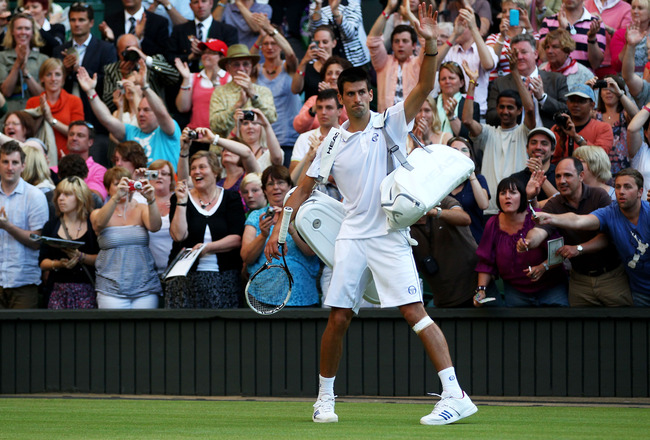 LONDON, ENGLAND - JUNE 25:  Novak Djokovic of Serbia walks off court after winning his third round match against Marcos Baghdatis of Cyprus on Day Six of the Wimbledon Lawn Tennis Championships at the All England Lawn Tennis and Croquet Club on June 25, 2