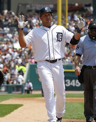 DETROIT - JUNE 26: Jhonny Peralta #27 of the Detroit Tigers celebrates a solo home run in the second inning during the game against the Arizona Diamondbacks at Comerica Park on June 26, 2011 in Detroit, Michigan.  (Photo by Leon Halip/Getty Images)