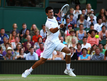 LONDON, ENGLAND - JUNE 25:  Novak Djokovic of Serbia returns a shot during his third round match against Marcos Baghdatis of Cyprus on Day Six of the Wimbledon Lawn Tennis Championships at the All England Lawn Tennis and Croquet Club on June 25, 2011 in L