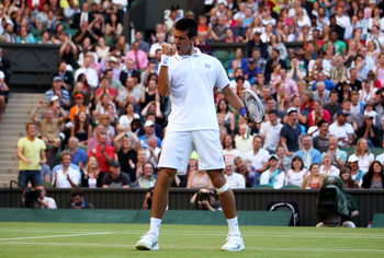LONDON, ENGLAND - JUNE 25:  Novak Djokovic of Serbia reacts to a play during his third round match against Marcos Baghdatis of Cyprus on Day Six of the Wimbledon Lawn Tennis Championships at the All England Lawn Tennis and Croquet Club on June 25, 2011 in