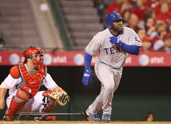 ANAHEIM, CA - APRIL 04:  Milton Bradley #21 of the Texas Rangers hits a double in the 4th inning against the Los Angeles Angels of Anaheim at Angels Stadium April 4, 2008 in Anaheim, California.  (Photo by Lisa Blumenfeld/Getty Images)