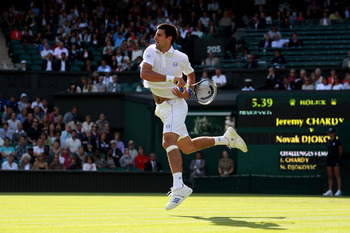 LONDON, ENGLAND - JUNE 21:  Novak Djokovic of Serbia in action during his first round match against Jeremy Chardy of France on Day Two of the Wimbledon Lawn Tennis Championships at the All England Lawn Tennis and Croquet Club on June 21, 2011 in London, E
