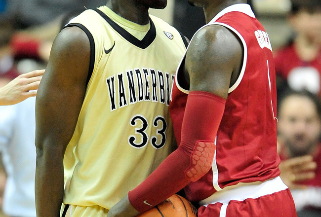 NASHVILLE, TN - FEBRUARY 10:  Steve Tchiengang #33 of the Vanderbilt Commodores and JaMychal Green #1 of the Alabama Crimson Tide exchange words at Memorial Gym on February 10, 2011 in Nashville, Tennessee. Vanderbilt won 81-77. (Photo by Grant Halverson/