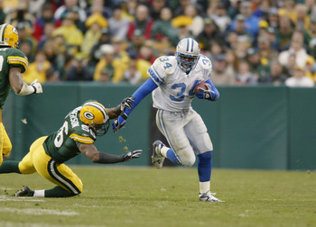 GREEN BAY, WI - NOVEMBER 10:  Running Back James Stewart #34 of the Detroit Lions attempts to avoid the tackle during the NFL game against the Green Bay Packers at Lambeau Field on November 10, 2002 in Green Bay, Wisconsin. The Packers defeated the Lions