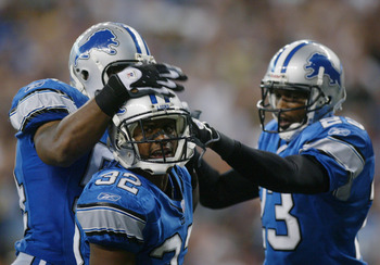 DETROIT, MI - SEPTEMBER 7:  Cornerback Dre Bly #32 of the Detroit Lions celebrates with linebacker Barrett Green #54 and cornerback Otis Smith #23 during the game against the Arizona Cardinals at Ford Field on September 7, 2003 in Detroit, Michigan. The L