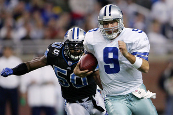 DETROIT - DECEMBER 09:  Quarterback Tony Romo #9 of the Dallas Cowboys makes a break chased by Ernie Sims #50 of the Detroit Lions on December 9, 2007 at Ford Field in Detroit, Michigan. The Cowboys won the match 28-27.  (Photo by Chris McGrath/Getty Imag