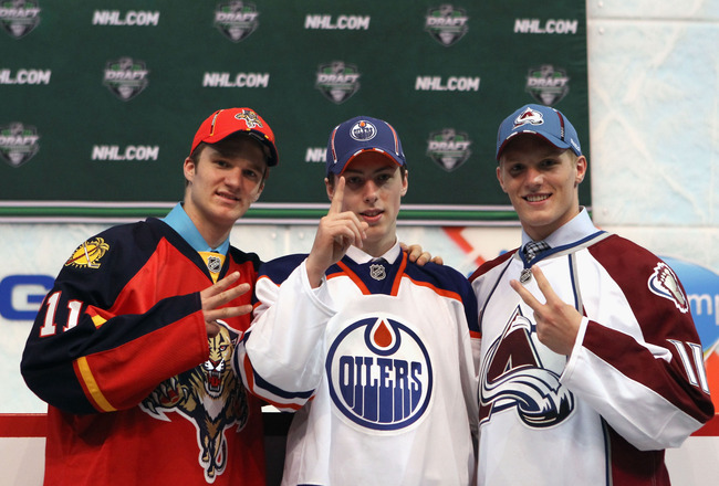 ST PAUL, MN - JUNE 24:  (L-R) Third overall pick Jonathan Huberdeau of the Florida Panthers, first overall pick Ryan Nugent-Hopkins of the Edmonton Oilers and second overall pick Gabriel Landeskog of the Colorado Avalanche pose for a photo during day one