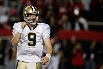 ATLANTA, GA - DECEMBER 27:  Quarterback Drew Brees #9 of the New Orleans Saints celebrates a touchdown pass to Jimmy Graham in the second half during the game against the Atlanta Falcons at the Georgia Dome on December 27, 2010 in Atlanta, Georgia.  (Phot