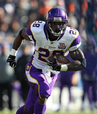 CHICAGO - NOVEMBER 14: Adrian Peterson #28 of the Minnesota Vikings runs against the Chicago Bears at Soldier Field on November 14, 2010 in Chicago, Illinois. The Bears defeated the Vikings 27-13.  (Photo by Jonathan Daniel/Getty Images)