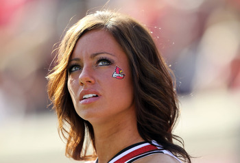LOUISVILLE, KY - NOVEMBER 20:  A Louisville Cardinals cheerleader watches the Big East Conference game against the West Virginia Mountaineers at Papa John's Cardinal Stadium on November 20, 2010 in Louisville, Kentucky.  (Photo by Andy Lyons/Getty Images)
