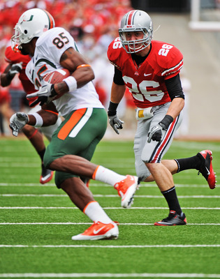 COLUMBUS, OH - SEPTEMBER 11:  Tyler Moeller #26 of the Ohio State Buckeyes chases down a Miami Hurricanes ballcarrier at Ohio Stadium on September 11, 2010 in Columbus, Ohio.  (Photo by Jamie Sabau/Getty Images)