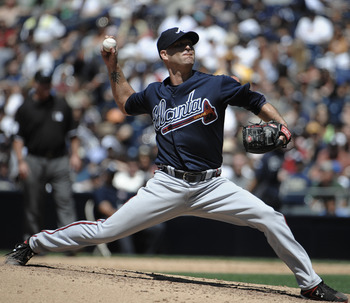 SAN DIEGO, CA - JUNE 26: Tim Hudson #15 of the Atlanta Braves pitches during the fifth inning of a baseball game against the San Diego Padres at Petco Park on June 26, 2011 in San Diego, California.  (Photo by Denis Poroy/Getty Images)
