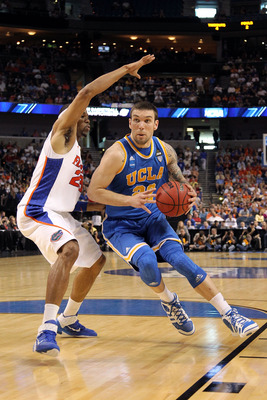 TAMPA, FL - MARCH 19:  Reeves Nelson #22 of the UCLA Bruins drives against Alex Tyus #23 of the Florida Gators during the third round of the 2011 NCAA men's basketball tournament at St. Pete Times Forum on March 19, 2011 in Tampa, Florida. Florida won 73-