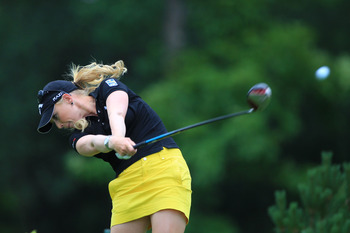 PITTSFORD, NY - JUNE 26: Morgan Pressel hits her tee shot on the fourth hole during the final round of the Wegmans LPGA Championship at Locust Hill Country Club on June 26, 2011 in Pittsford, New York. (Photo by Hunter Martin/Getty Images)