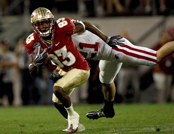 ORLANDO, FL - DECEMBER 27:  Bert Reed #83 of the Florida State Seminoles breaks the tackle of Chris Maragos #21 of the Wisconsin Badgers during the Champs Bowl on December 27, 2008 at the Citrus Bowl in Orlando, Florida.  (Photo by Sam Greenwood/Getty Ima