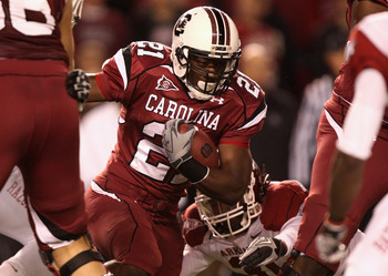 COLUMBIA, SC - NOVEMBER 06:  Jerico Nelson #31 of the Arkansas Razorbacks tries to stop Marcus Lattimore #21 of the South Carolina Gamecocks during their game at Williams-Brice Stadium on November 6, 2010 in Columbia, South Carolina.  (Photo by Streeter L