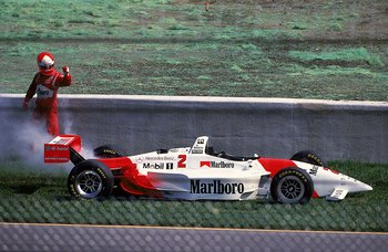 22 Aug 1999:  Driver Al Unser Jr.of the USA who drives the Mercedes Penske PC28 for Marlboro Team Penske walks away from his car as it smokes on the side of the track during the Target Grand Prix Presented by Shell, part of the CART FedEx Championship Ser