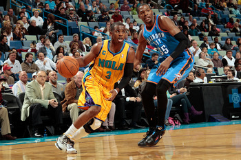 NEW ORLEANS, LA - DECEMBER 10:  Chris Paul #3 of the New Orleans Hornets drives the ball around Kevin Durant #35 of the Oklahoma City Thunder at New Orleans Arena on December 10, 2010 in New Orleans, Louisiana.    NOTE TO USER: User expressly acknowledges