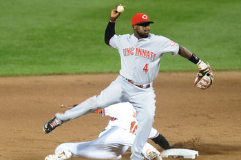 BALTIMORE, MD - JUNE 25:  Brandon Phillips #4 of the Cincinnati Reds makes the force at second base as Adam Jones #10 of the Baltimore Orioles slides during a baseball game on June 25, 2011 at Orioles Park at Camden Yards in Baltimore, Maryland.  The Reds