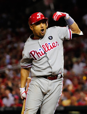 ST. LOUIS, MO - JUNE 21: Placido Polanco #27 of the Philadelphia Phillies reacts after being hit by a pitch thrown by Jason Motte #30 of the St. Louis Cardinals at Busch Stadium on June 21, 2011 in St. Louis, Missouri.  (Photo by Jeff Curry/Getty Images)