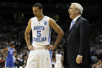 NEWARK, NJ - MARCH 27:  Kendall Marshall #5 of the North Carolina Tar Heels talks with head coach Roy Williams during the first half of the game against the Kentucky Wildcats in the east regional final of the 2011 NCAA men's basketball tournament at Prude