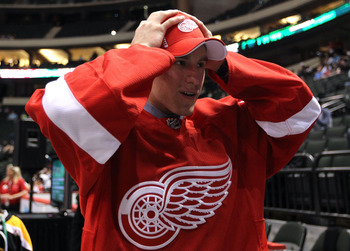 ST PAUL, MN - JUNE 25:  Philippe Hudon, drafted 145th overall by the Detroit Red Wings, walks to greet members of the Red Wings during day two of the 2011 NHL Entry Draft at Xcel Energy Center on June 25, 2011 in St Paul, Minnesota.  (Photo by Bruce Benne