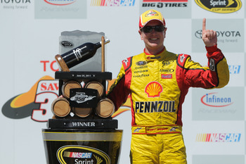 SONOMA, CA - JUNE 26:  Kurt Busch, driver of the #22 Shell/Pennzoil Dodge, celebrates in victory lane after winning the NASCAR Sprint Cup Series Toyota/Save Mart 350 at Infineon Raceway on June 26, 2011 in Sonoma, California.  (Photo by Justin Edmonds/Get