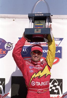 17 Aug 2000: Juan Montoya of Columbia who drives the Toyota Lola B2K/00 for Target/ Chip Ganssi Racing poses with his winning trophy after the Motorola 300, part of the 2000 CART FedEx Championship series at the Gateway International Raceway in Madison, I