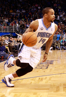 ORLANDO, FL - JANUARY 24:  Jameer Nelson #14 of the Orlando Magic drives to the basket during the game against the Detroit Pistons at Amway Arena on January 24, 2011 in Orlando, Florida.  NOTE TO USER: User expressly acknowledges and agrees that, by downl