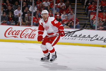 DETROIT, MI - MARCH 30:  Henrik Zetterberg #40 of the Detroit Red Wings skates against the St. Louis Blues at Joe Louis Arena on March 30, 2011 in Detroit, Michigan.  (Photo by Gregory Shamus/Getty Images)